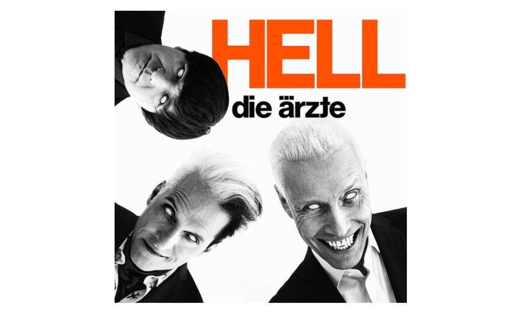 Das Cover des neuen Albums HELL von DIE ÄRZTE (Promo). Drei Musiker - Rodrigo Gonzalez, Bela B und Farin Urlaub - blicken mit teuflischen Blicken in die Kamera